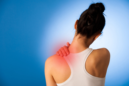 58438444 - waman having pain in her neck over blue background